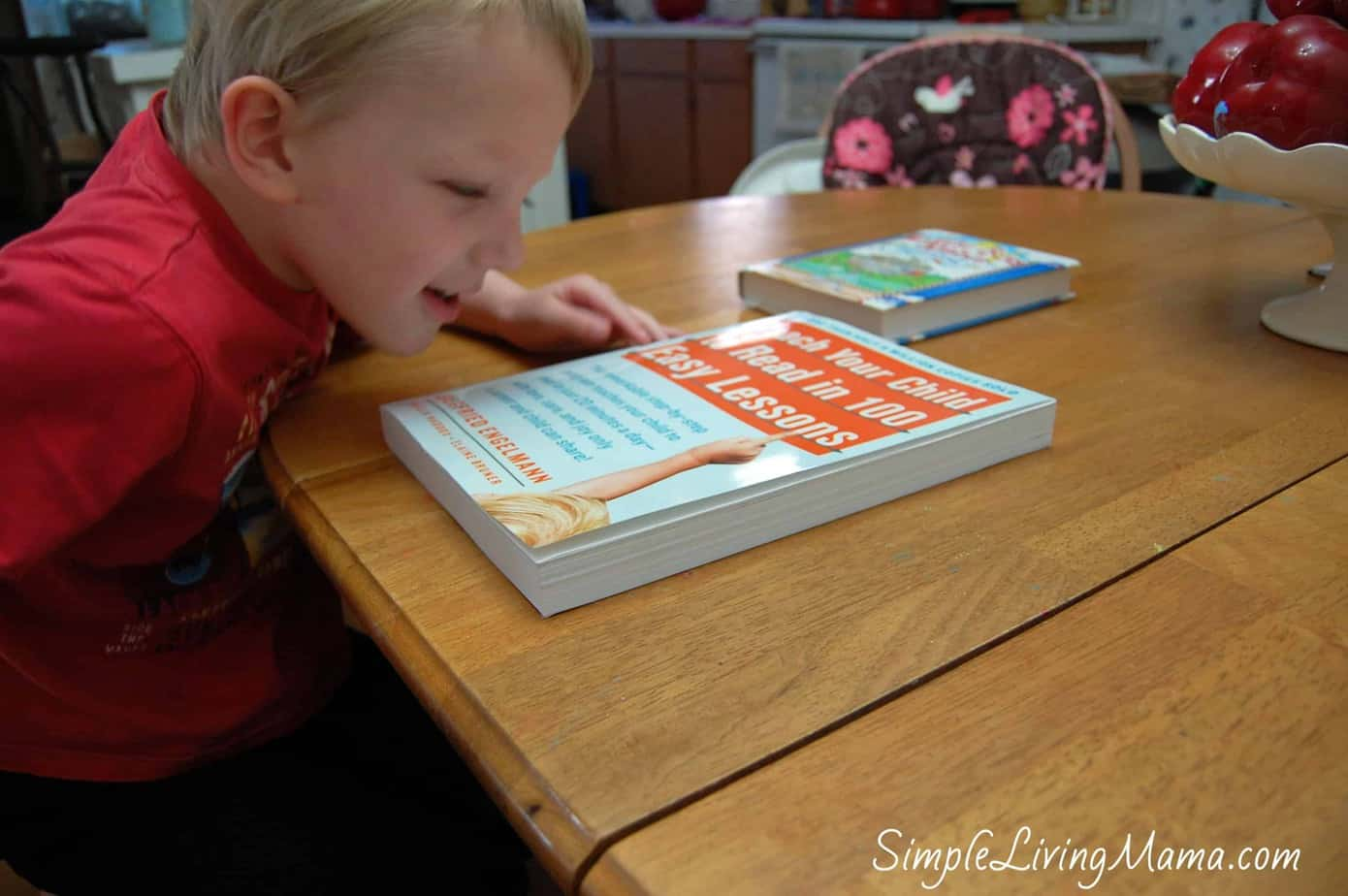 Child look at Teach Your Child to Read in 100 Easy Lessons