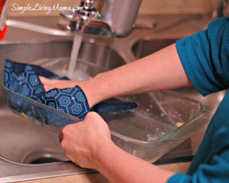 scrubbing the dish