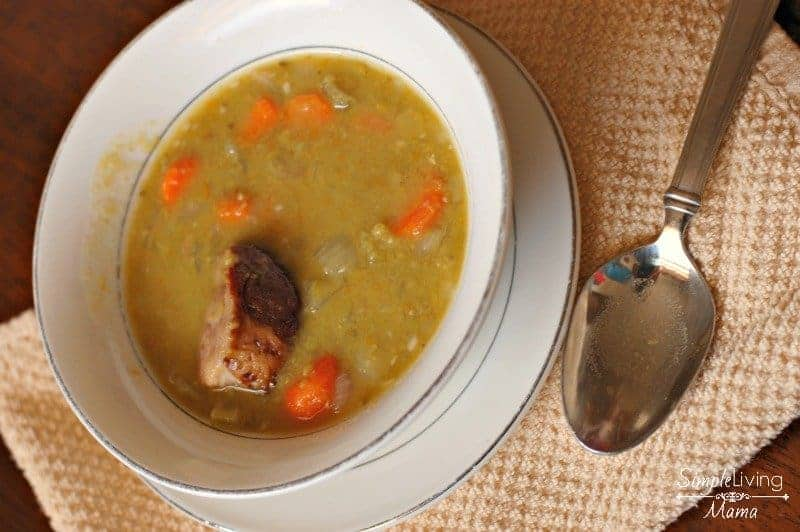 A white bowl filled with slow cooker split pea soup.