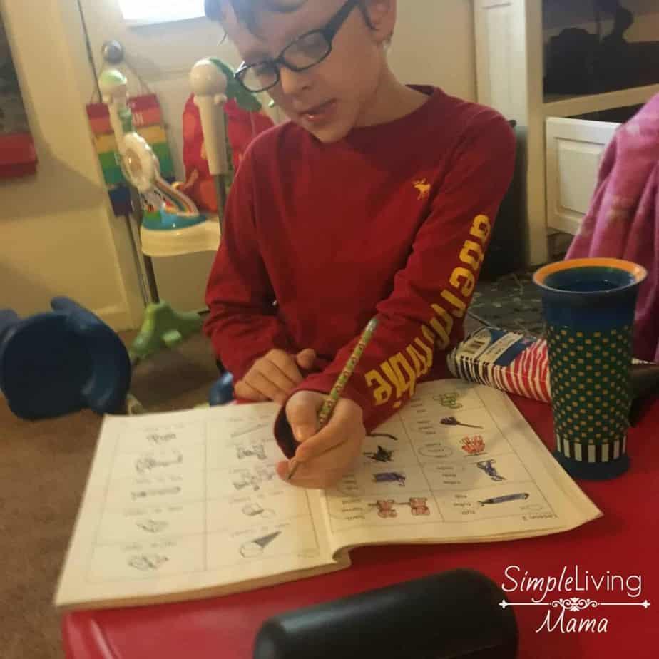 Child using Explode the Code workbook