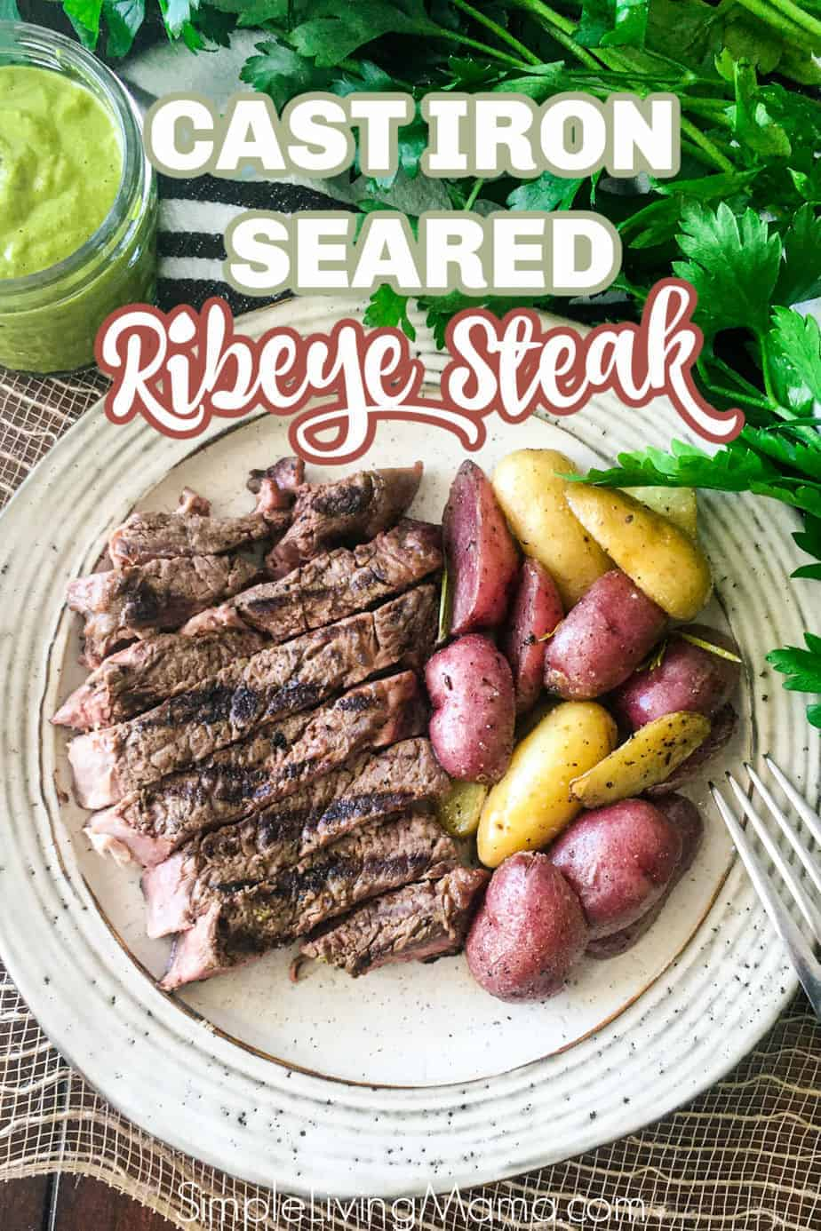 A delicious cast iron seared ribeye steak served alongside roasted potatoes.